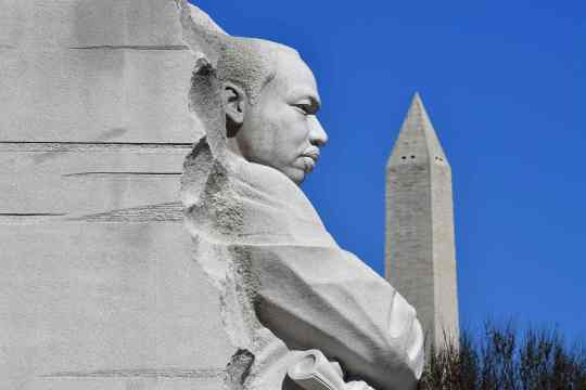 "The Washington Memorial is seen behind the ""Stone of Hope"" statue at the Martin Luther King Jr. Memorial in Washington, D.C. on March 19, 2019."