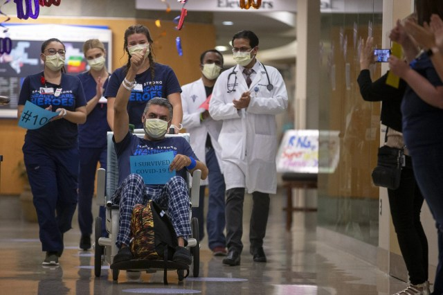Joel Hernandez Valdez, the 100th patient to recover from COVID-19 at Banner Baywood Medical Center, is discharged on June 5, 2020, in Mesa, Ariz.