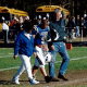 Barbara Clark (left) and Larry Clark escort L.J. Clark during his Senior Day with Lakewood High School football in 1998.