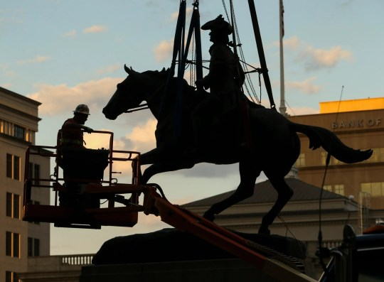 The statue of Caesar Rodney is hoisted from its pedestal on Rodney Square in Wilmington on June 12, 2020.