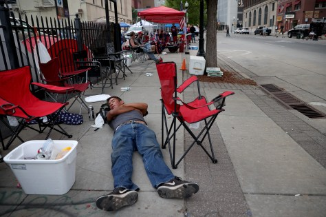TULSA, OKLAHOMA - JUNE 19: Supporters of U.S. President Donald Trump sleep in the early morning while lined up to attend the campaign rally of U.S. President Donald Trump near the BOK Center, site of tomorrow's rally, June 19, 2020 in Tulsa, Oklahoma. Trump is scheduled to hold his first political rally since the start of the coronavirus pandemic at the BOK Center on Saturday while infection rates in the state of Oklahoma continue to rise.  (Photo by Win McNamee/Getty Images) ORG XMIT: 775525014 ORIG FILE ID: 1250658372