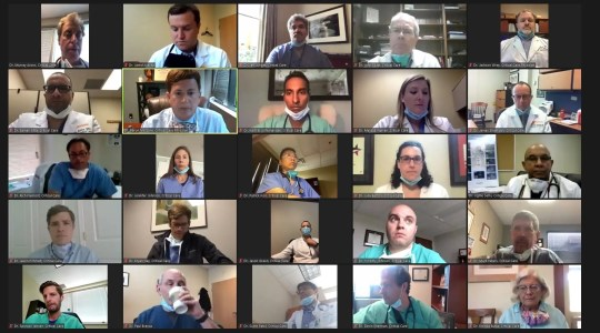 Dozens of Tennessee doctors begged Gov. Bill Lee to make masks mandatory and take fiercer action to stop the coronavirus during a video-chat press conference on Monday. The group is led by Dr. Aaron Milstone, upper left, highlighted in yellow.
