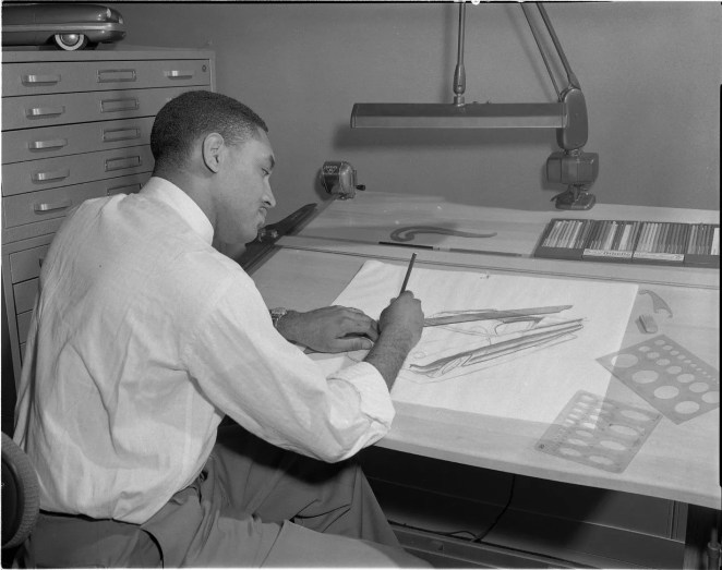 McKinley Thompson Jr., who won a national design contest, went to work at Ford in 1956. He sketched the first Bronco and took part in other projects including Mustang and Thunderbird. He is pictured here working at his desk circa 1958.