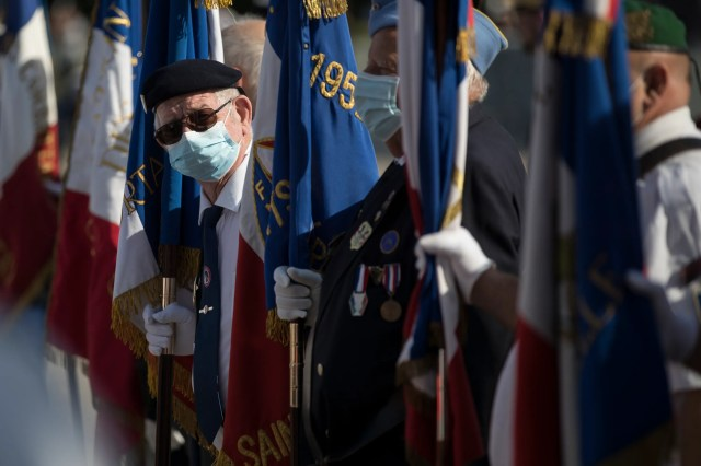 A veteran wears a face mask prior to a Bastille Day ceremony at Parc Borely, Tuesday, July 14, 2020 in Marseille, southern France. France is honoring nurses, ambulance drivers, supermarket cashiers and others on its biggest national holiday Tuesday. Bastille Day's usual grandiose military parade in Paris is being redesigned this year to celebrate heroes of the coronavirus pandemic.