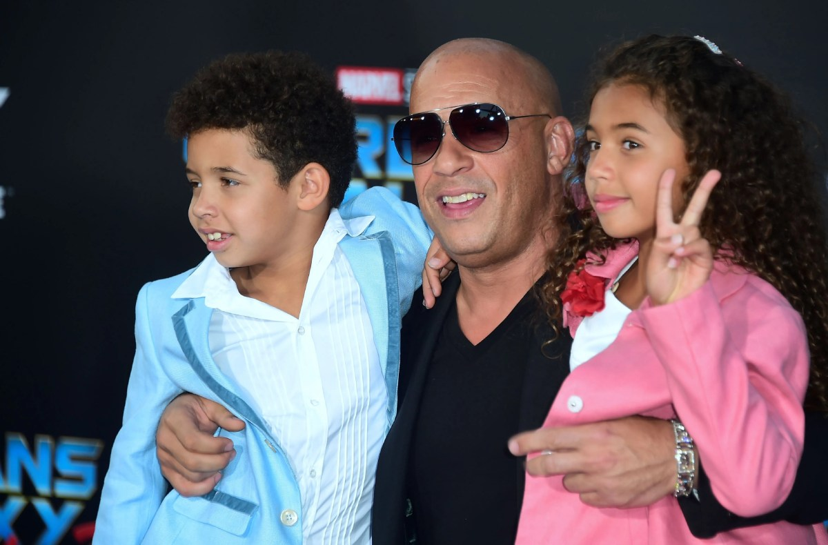 """Vin Diesel strikes a pose with his children for the world premiere of the film """"Guardians of the Galaxy Vol. 2"""" in 2017."""