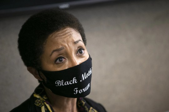 Janelle Wood, founder of the Black Mothers Forum, looks on during a press conference with Dion Johnson's family and their attorney, Jocquese Blackwell, at Blackwell's law office in Phoenix on July 16, 2020. Johnson was killed by Department of Public Safety trooper George Cervantes after he was found asleep in his car on the Loop 101 in Phoenix on May 25, 2020. The Phoenix Police Department released a report on July 15, detailing the criminal investigation into the fatal shooting.