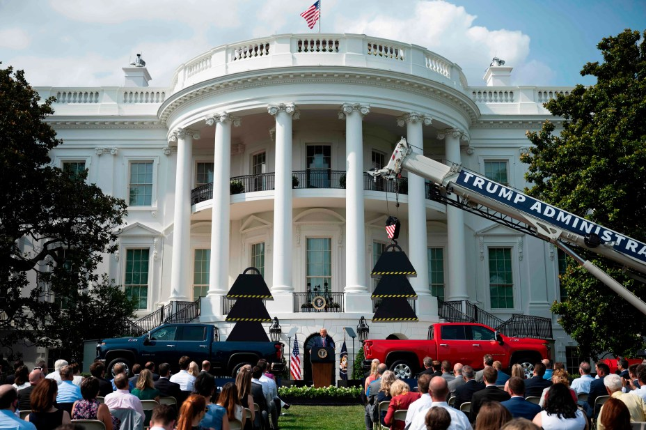 President Donald Trump delivers remarks on rolling back federal regulations during an event on the White House South Lawn. He also used the event to attack Democratic rival Joe Biden.