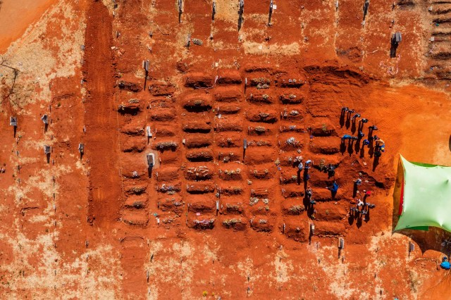 This aerial picture shows a funeral taking place at the Olifantsvlei Cemetery in Soweto, on July 23, 2020.