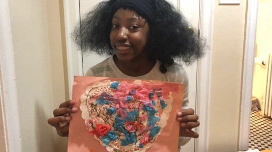 Shirley holds a work of art she created while she was attending High Road.