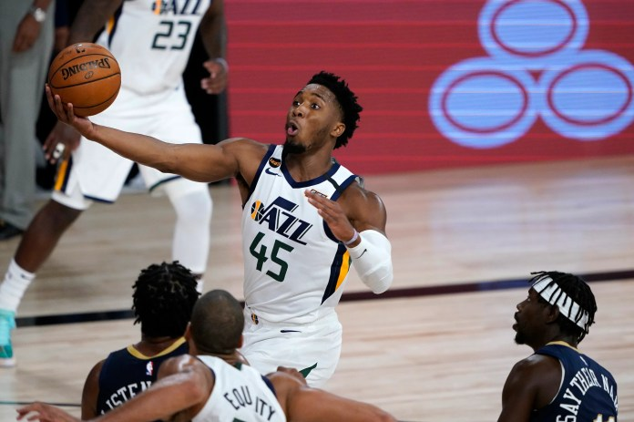 July 30: Jazz guard Donovan Mitchell drives to the bucket against the Pelicans.