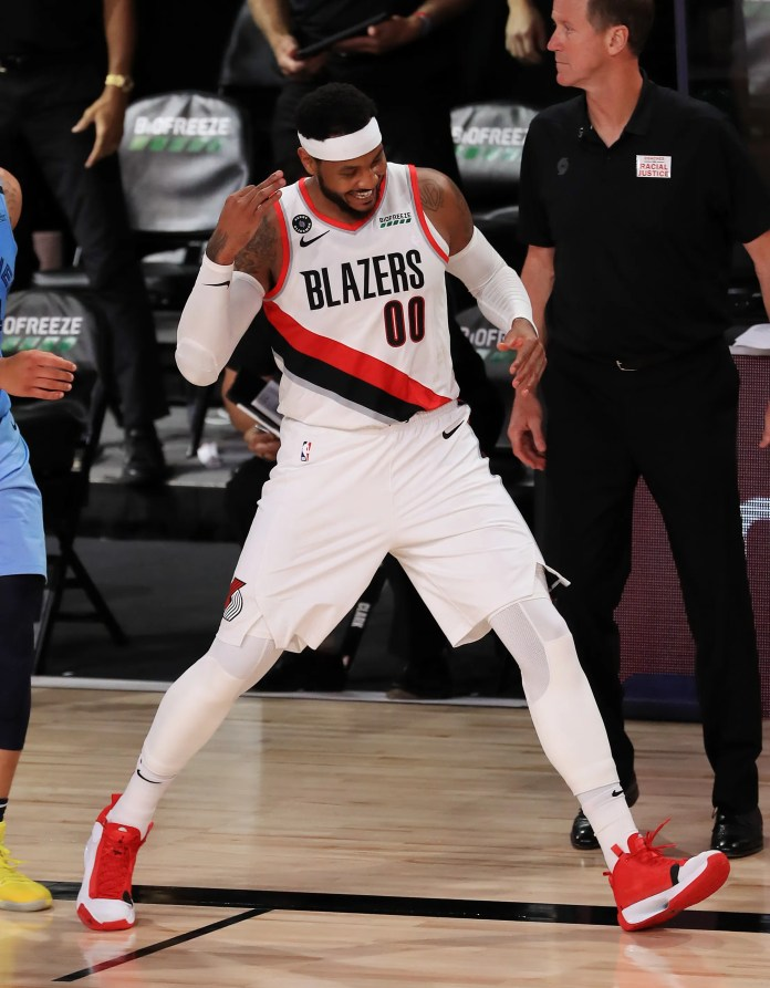 July 31: Blazers forward Carmelo Anthony celebrates after hitting a big 3 late against the Grizzlies.