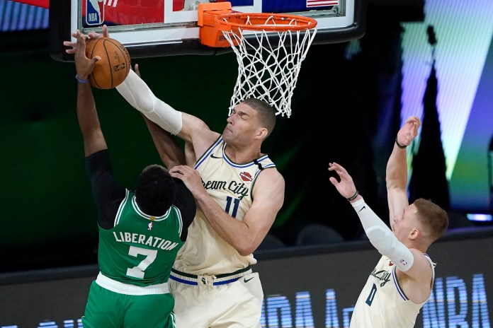 July 31: Bucks center Brook Lopez denies Celtics forward Jaylen Brown at the rim.