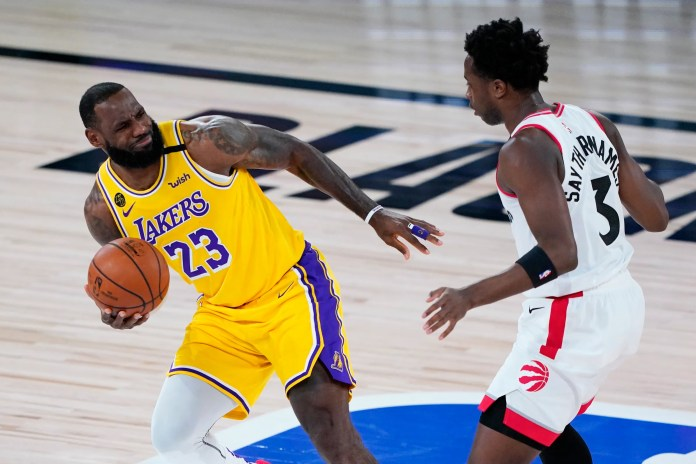 Aug. 1: Lakers forward LeBron James draws contact against Raptors defender O.G. Anunoby.