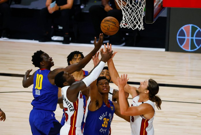 Aug. 1: The pack goes up for a rebound during the Heat-Nuggets game.