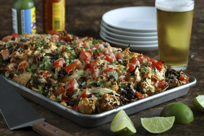 Roasted cauliflower becomes the star for a twist on nachos. It's still decadent with plenty of melted cheese, but also somewhat healthier than standard nachos. (Abel Uribe/Chicago Tribune/TNS)