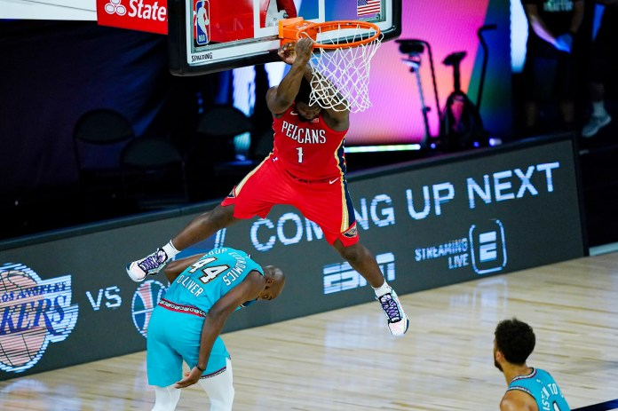 Aug. 3: Pelicans forward Zion Williamson throws down the monster two-handed alley-oop against the Grizzlies.