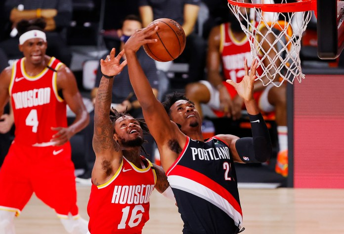 Aug. 4: Ben McLemore of the Houston Rockets and Hassan Whiteside of the Portland Trail Blazers battle for a rebound during the Blazers' 110-102 win.