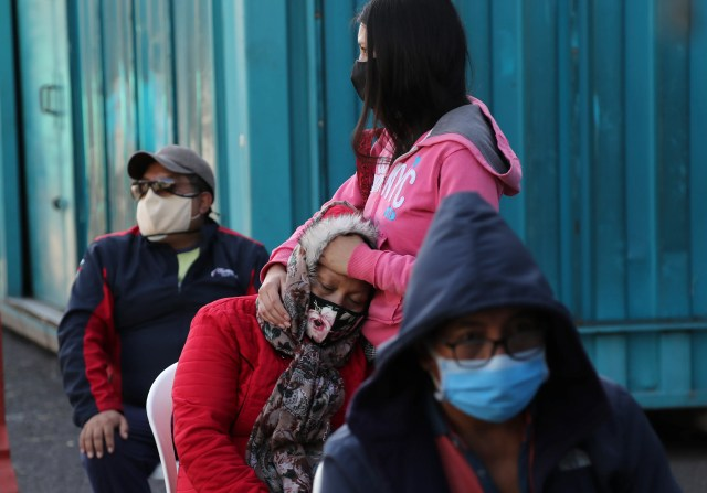 People line up to be tested for COVID-19 at the Unidad Educativa Quitumbe school that is being used as a triage unit and to help hospitals that are operating at the limit of their capacity during the new coronavirus pandemic, in Quito, Ecuador, Aug. 3, 2020.