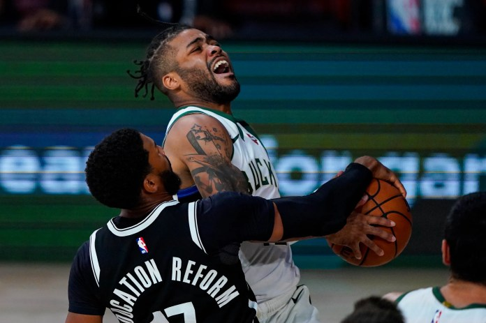 Aug. 4: The Milwaukee Bucks' Frank Mason III is fouled as he shoots by the Brooklyn Nets' Garrett Temple during the Nets' 119-116 win.