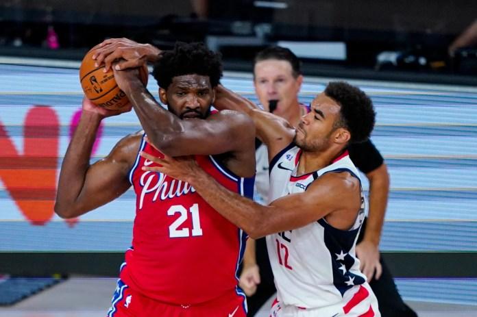 Aug. 5: Washington Wizards guard Jerome Robinson (12) tries to tie up Philadelphia 76ers center Joel Embiid.