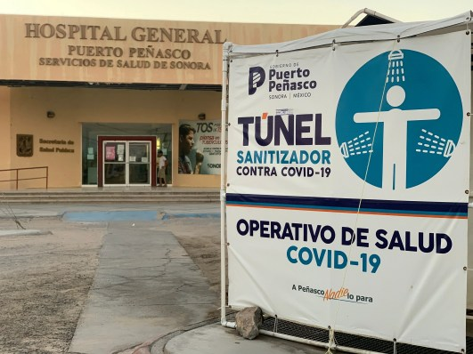 "The local government in Puerto Peñasco set up ""sanitation tunnels"" outside key points throughout the city, such as the state-run General Hospital, to fight COVID-19."