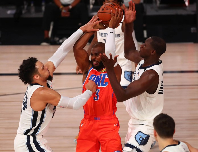 Aug. 7: Thunder guard Chris Paul (3) tries to pas out of a double-team by Grizzlies defenders Dillon Brooks (24) and Gorgui Dieng (14).