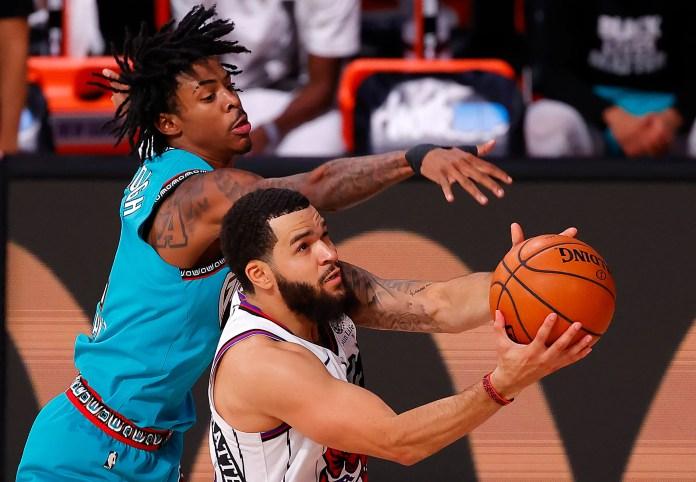 Aug. 9: Raptors guard Fred VanVleet drives to the bucket against Grizzlies defender Ja Morant.