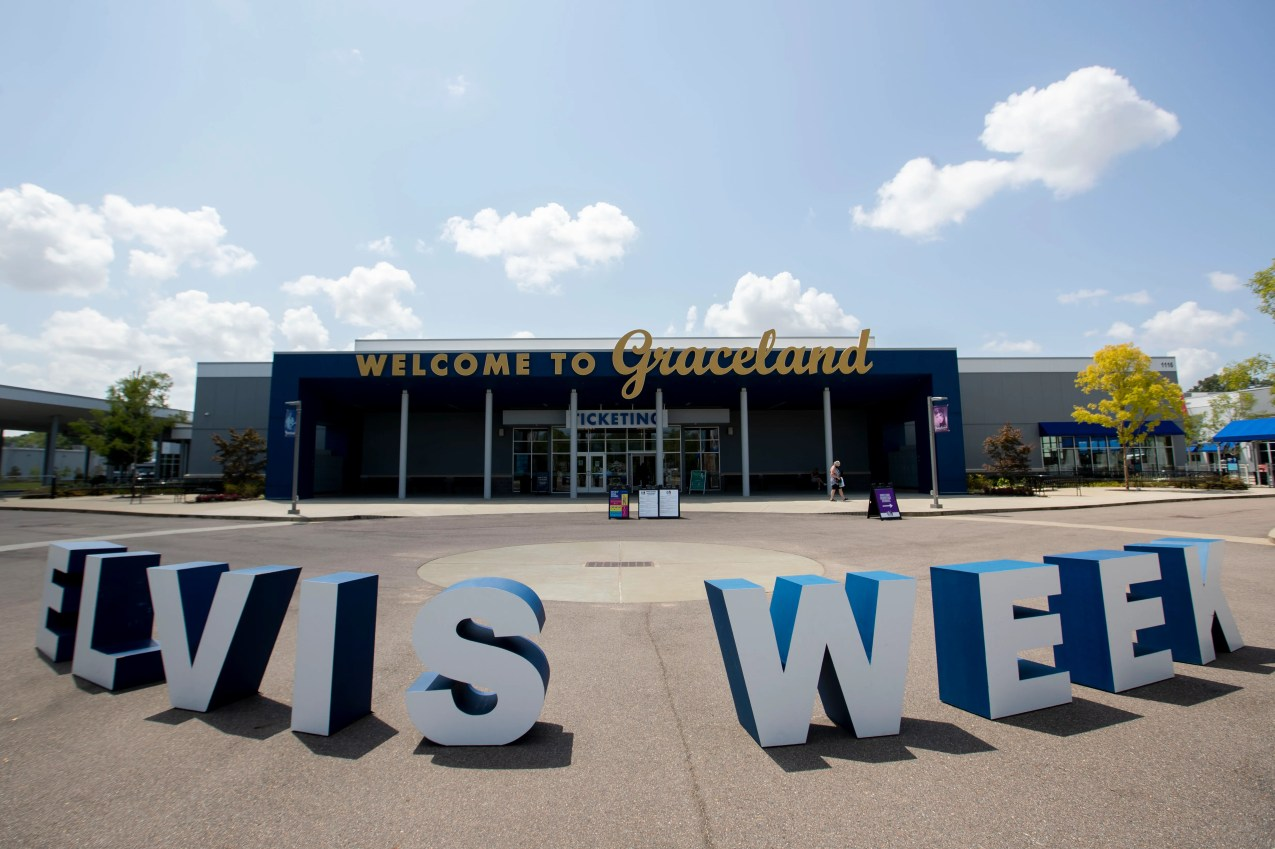 An Elvis Week sign sits in front of the entrance to Elvis Presley's Memphis on Tuesday, Aug. 11, 2020, at Graceland in Memphis.