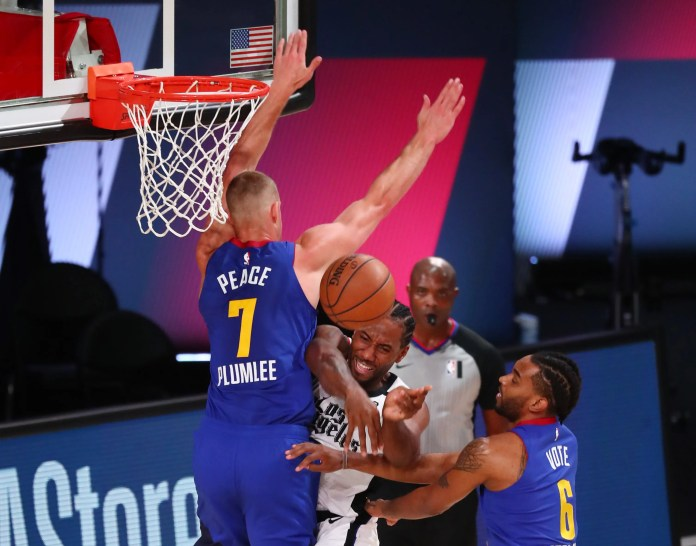 Aug. 12: Clippers forward Kawhi Leonard (2) tries to pass out of the double-team by NUggets defenders Mason Plumlee (7) and Keita Bates-Diop (6).