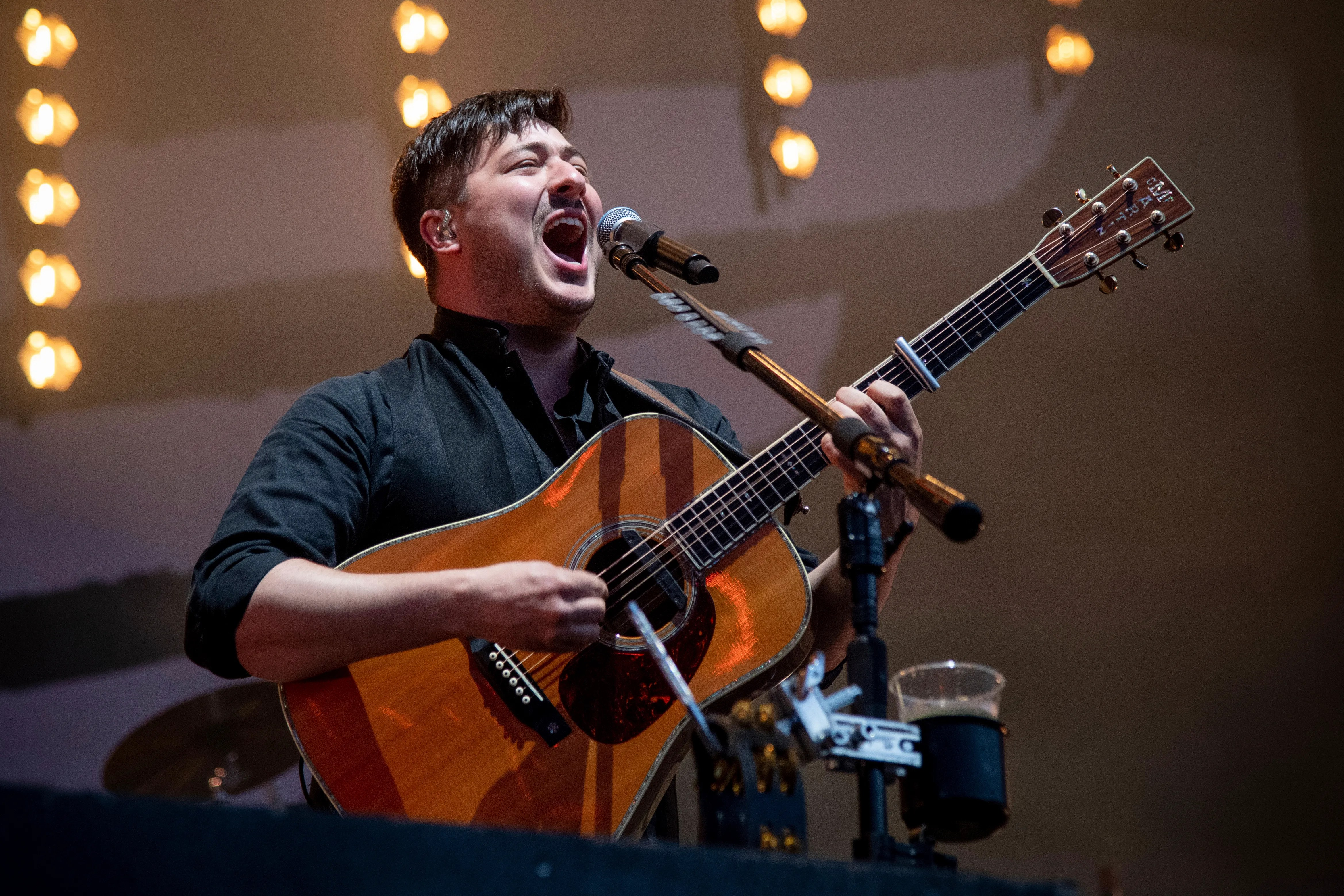 I am learning how to play the guitar and what famous song would be easy to play. Mumford Sons Frontman On Ted Lasso Gardening And Afc Wimbledon