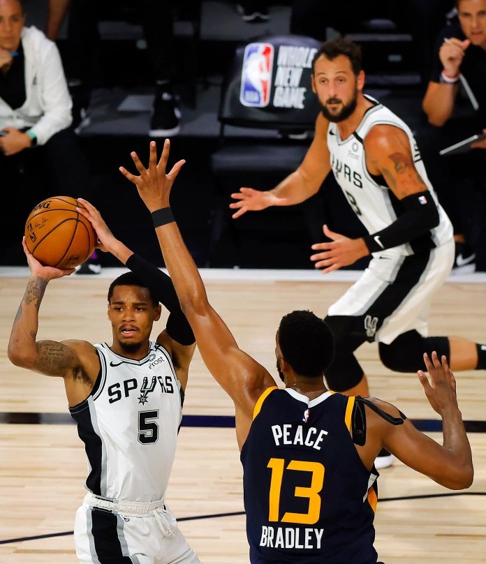 Aug. 13: The San Antonio Spurs' Dejounte Murray looks to pass against the Utah Jazz. The Jazz won the game, 118-112.