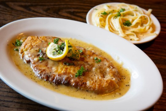 Red Snapper Francese with a side of fettuccine alfredo.