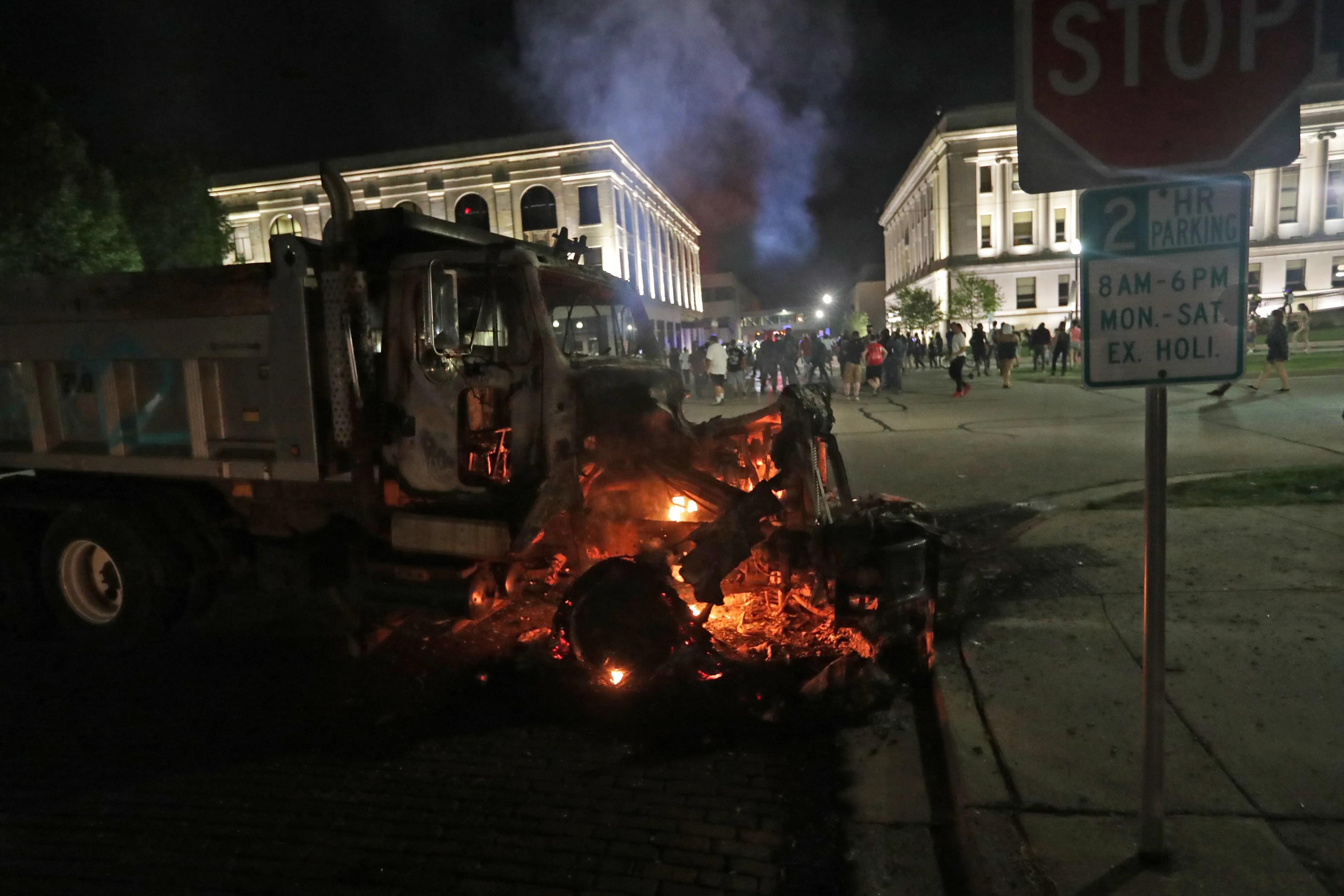 A city truck burns outside the Kenosha County courthouse in Kenosha on Sunday, Aug. 23, 2020.