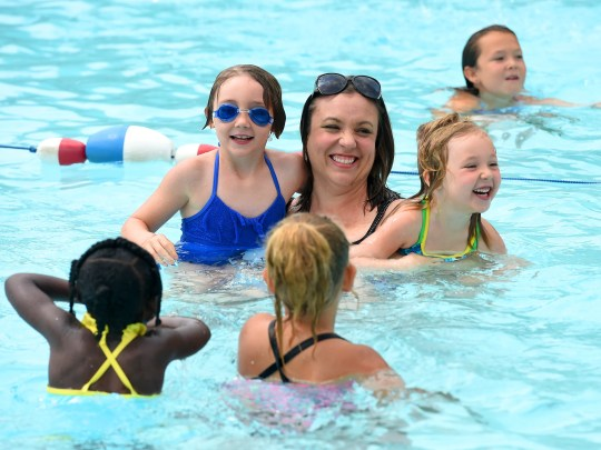 Charlotte Gingerelli swims with daughters Lucy Gingerelli and Francie Ginerelli at the Gypsy Hill Park pool in 2016. Charlotte was killed in a car wreck Sunday morning.