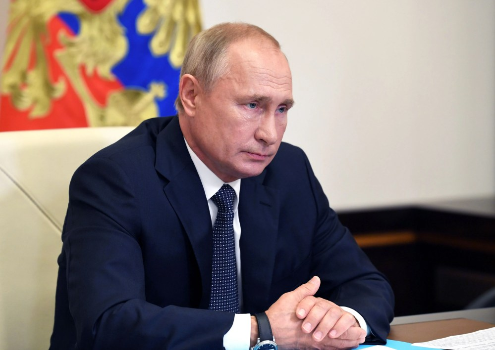 Russian President Vladimir Putin chairs a meeting with members of the government via a teleconference call.