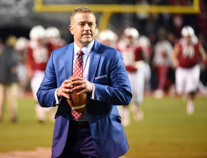 ESPN analyst Kirk Herbstreit throws the football prior to a game between the Clemson Tigers and North Carolina State Wolfpack at Carter-Finley Stadium.