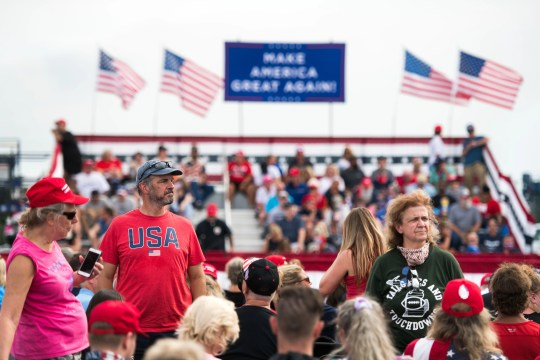 People wait for the arrival of President Donald Trump before a campaign rally at Smith Reynolds Airport on September 8, 2020 in Winston Salem, North Carolina.