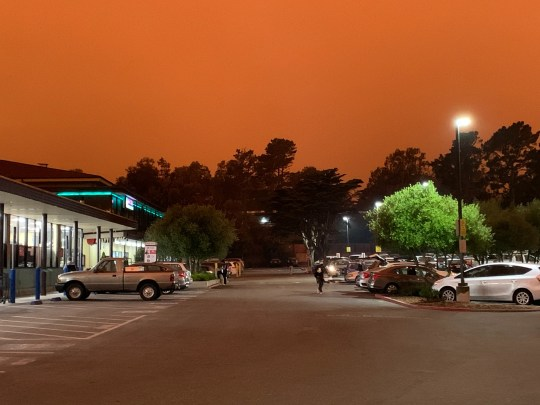 The parking lot of a Safeway supermarket in San Francisco's Diamond Heights neighborhood on Sept. 9, 2020, at 11:15 a.m. The reddish-orange tinge to the sky is from multiple wildfires in the region.