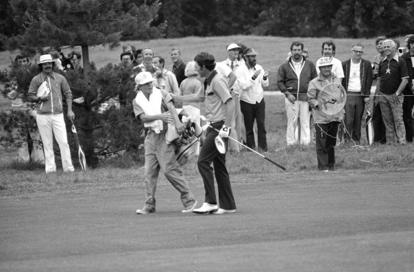 Peter McGarey, 16, of Scottsdale, Ariz., reaches to offer congratulations to Hale Irwin after the latter's fairway shot on the 18th reached the green and prior to Irwin's winning the U.S. Open golf championship, June 16, 1974, in Mamaroneck, N.Y.  Peter, formally of Larchmont, a neighboring town, was invited back to caddy in the Open by the caddie master at the Winged Foot Golf Club, site of the Open.