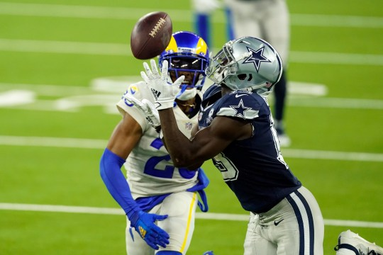 Dallas Cowboys wide receiver Michael Gallup, right, makes a catch but is called for offensive pass interference on Los Angeles Rams' Jalen Ramsey during fourth quarter.