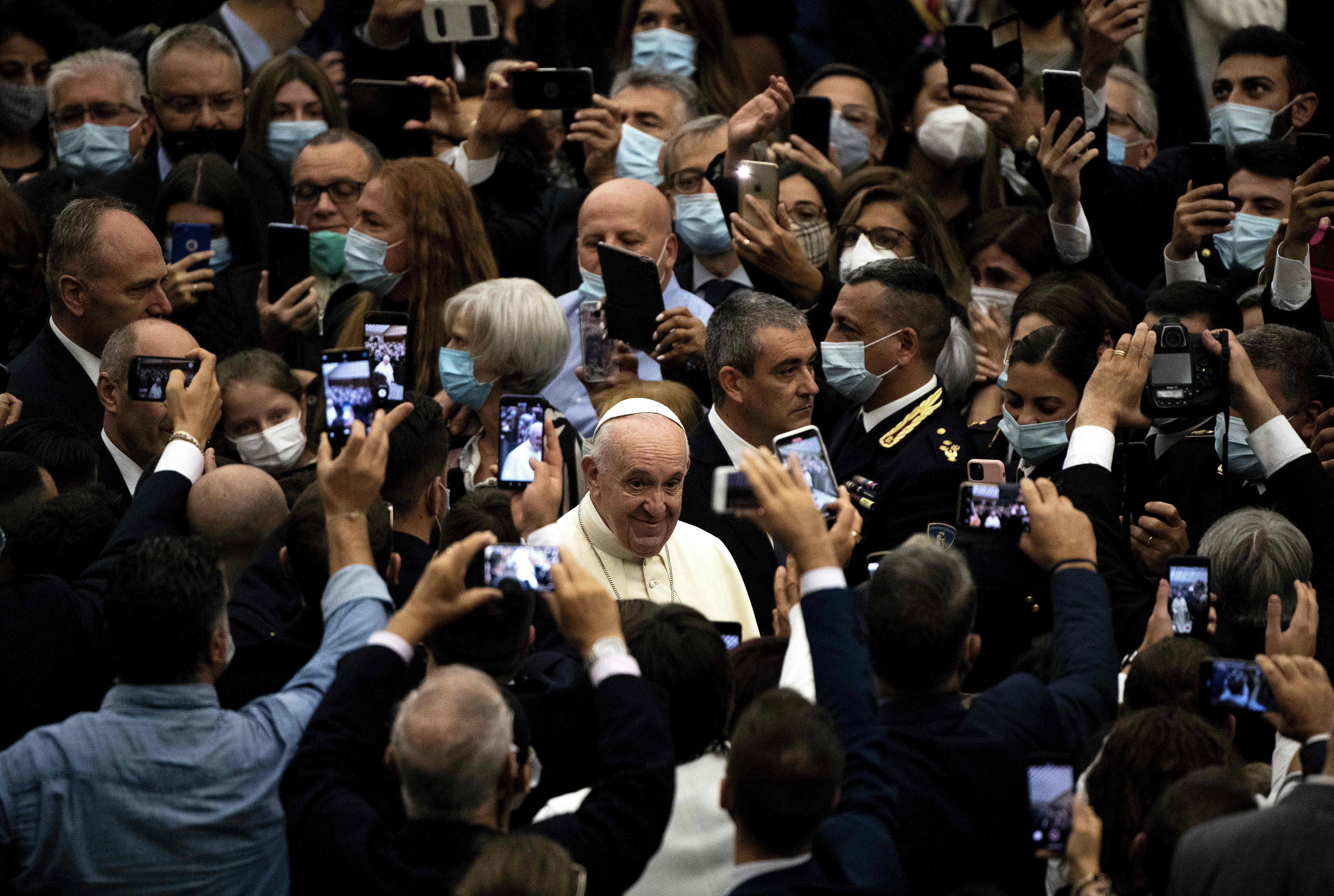 Pope Francis waves as he arrives for the general audience with members of the Italian Police on Sept. 28, 2020 in Paul VI hall at the Vatican.