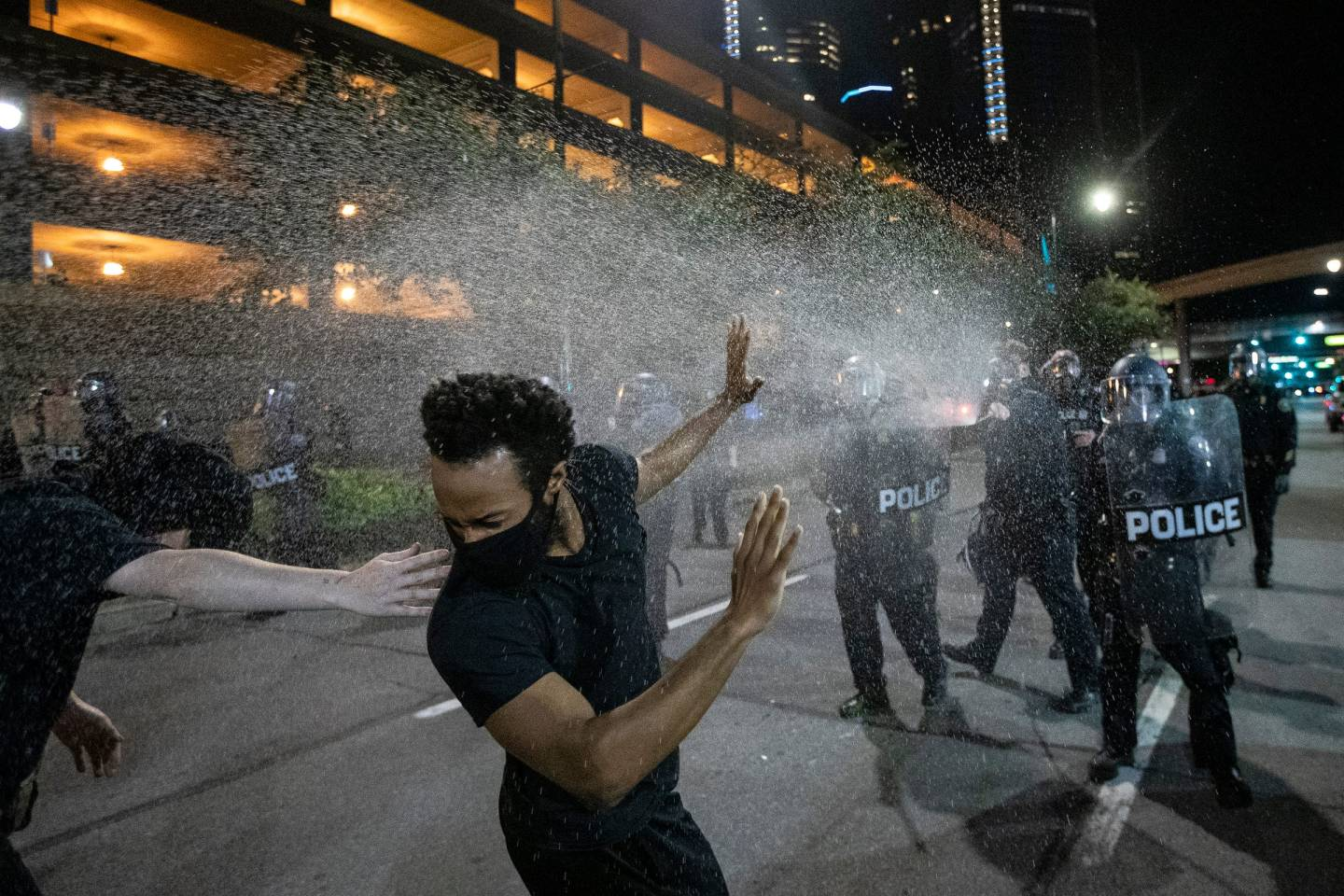 Protesters are being sprayed by Detroit Police officers in riot gear in downtown Detroit, Friday, May 29, 2020.