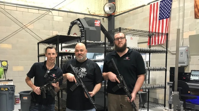 Garrett Porter, left – owner and founder of Special Ops Tactical – with two fellow machine gun manufacturers, Jimmy and Nate. Porter said his company, which usually sells between 5,000 to 9,000 AR-15s a year, has sold 20,000 semi-automatic rifles and machine guns so far in 2020and enough parts to make 10,000 more.