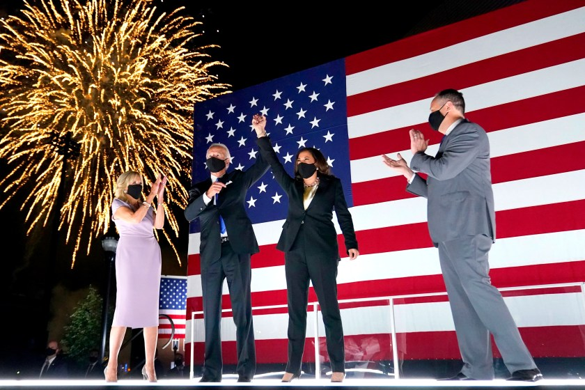 Joe Biden and running mate Sen. Kamala Harris, D-Calif., raise their arms up as fireworks go off on the fourth day of the Democratic National Convention, Thursday, Aug. 20, 2020, at the Chase Center in Wilmington, Del. Looking on are Jill Biden and Harris' husband Doug Emhoff.