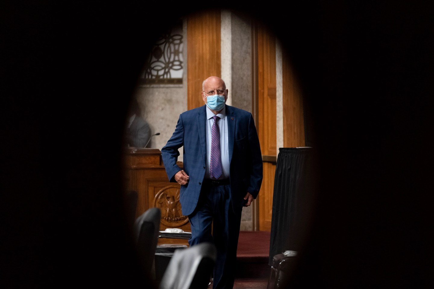 Dr. Robert Redfield seen through a door window at the Senate appropriations subcommittee hearing about coronavirus response efforts on Sept. 16.