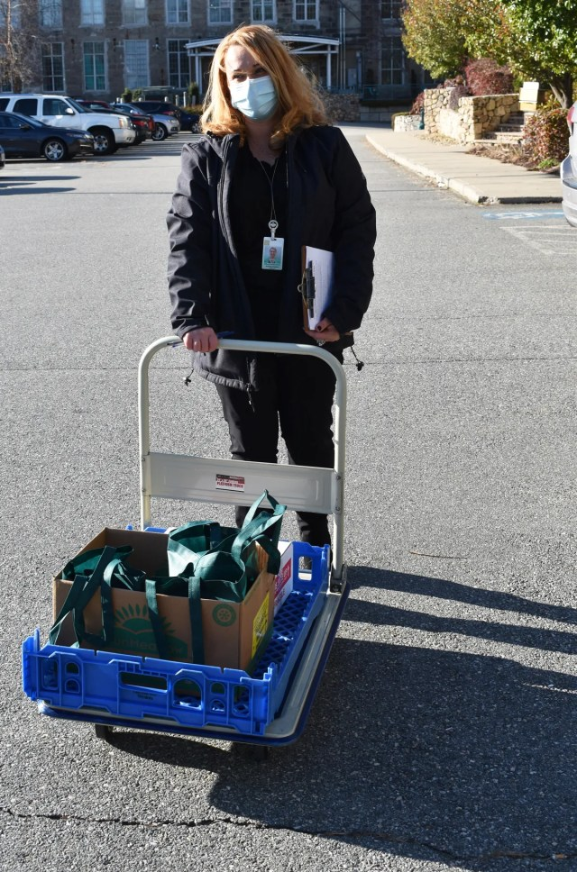Debbie Avila-Carreiro, nutrition program director for Bristol County Elder Services is ready to hand out bags of food to needy seniors Wednesday.