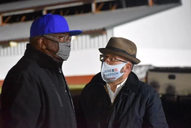 """South Carolina Rep. James Clyburn, the majority whip,  chatted with Trav Robertson, chairman of the South Carolina Democratic Party, at a drive-in rally Nov. 2, 2020 in Orangeburg.  """"Having him in leadership is a gift that cannot be overstated or overvalued,"""" Robertson said."""