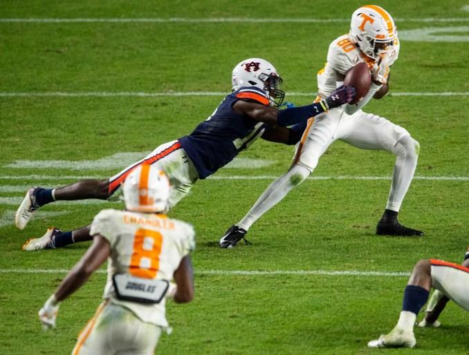 Auburn defensive back Nehemiah Pritchett (14) deflects a pass intended for Tennessee wide receiver Ramel Keyton (80) at Jordan-Hare Stadium in Auburn, Ala., on Saturday, Nov. 21, 2020. Auburn defeated Tennessee 30-17.