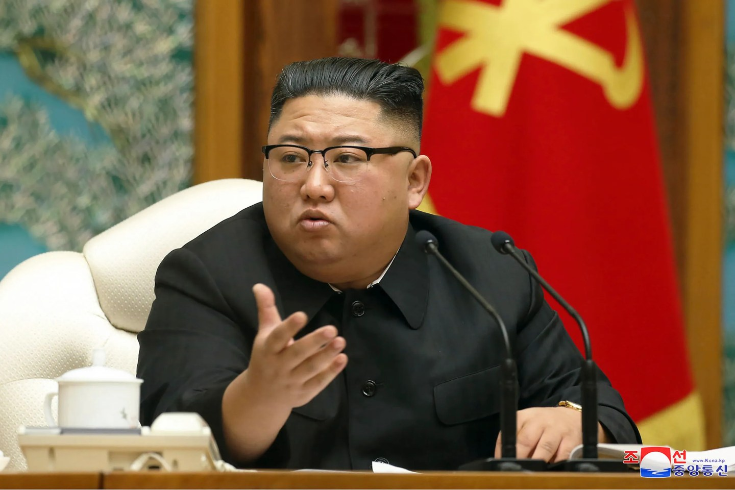 In this Nov. 15, 2020, file photo provided by the North Korean government, North Korean leader Kim Jong Un attends a meeting of the ruling Workers' Party Politburo in Pyongyang, North Korea. Kim ordered at least two people executed, banned fishing at sea and locked down capital Pyongyang as part of frantic efforts to guard against the coronavirus and its economic damage, South Korea's spy agency told lawmakers Friday, Nov. 27.