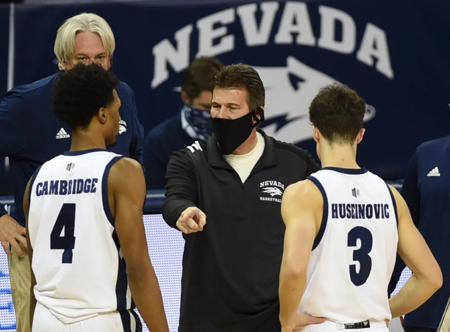 Nevada coach Steve Alford speaks with Desmond Cambridge, left, and Alem Huseinovic during a game against San Francisco last season.